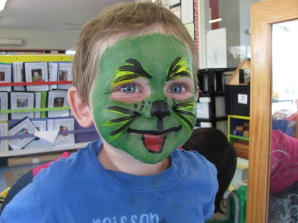 "Regan painted my face at playcenter. I'm a green tiger (my request). I'm obsessed with tigers, green and otherwise, and I'm sure my roars are more convincing when my face is painted. Naomi certainly thinks so--she startles and squints when I ROAR in her face. At least I get a reaction...when I read to her she doesn't even look at the pictures, even when I shout ""Pay Attention!"""