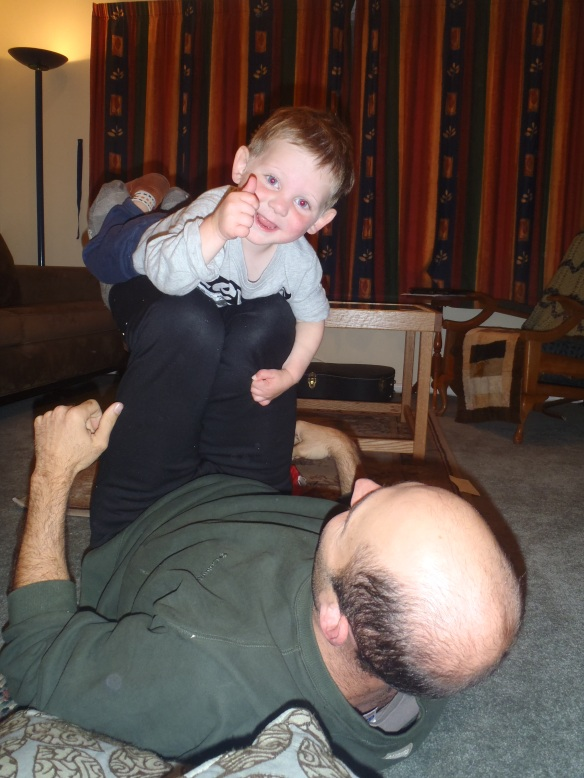 "I like it when Daddy comes home, puts down his iphone, and rowdy-plays with me! It's Friday, which means that Daddy's beard has grown since Monday. We were sitting at the table and I put my hand on Daddy's cheek and told him it was Rough, then put my hand on his head and told him it was Smooth. I put my hand on my own head and said ""Hair,"" meaning I have hair where Daddy's head is smooth. Daddy called me a ""Little Squirt"" and decided that we needed a little rowdy play before bed. I'm alright with that!"