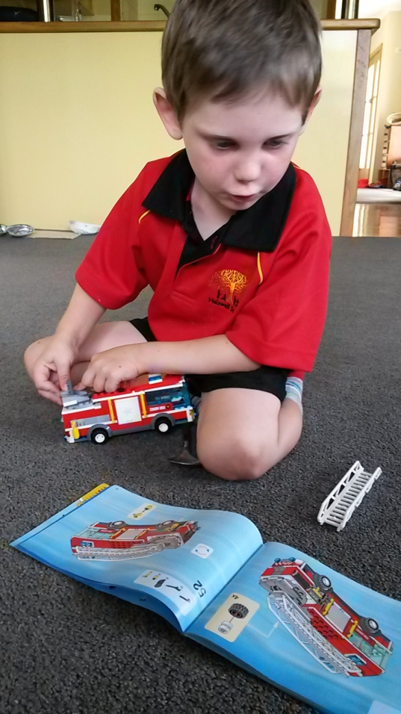 Yesterday I decided it was time to completely take apart my lego fire engine and rebuild it. I can follow the instructions all by myself, and the only time I needed Mom's help was when I couldn't find a piece. Turns out it wasn't stolen, as I had thought--Mom found it on the part I already put together. I was quite proud of the final construction!