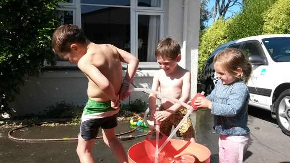 The fascination with what's inside their pants is in full swing. For some reason, Milo and his buddy decided that pumping cold hose water down their shorts would be delightful. They tried both the front and the back application, with Naomi in full cooperation.