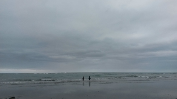 The beach was pretty quiet when we arrived, as it was overcast and a bit chill, but the novelty of going to the beach on Christmas day is still worth it for us.  Sand + Water = Kid Happiness.  Us parents sipped our coffees with Baileys and avoided the incoming tide.