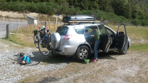 Every year I think Jeremiah can't fit another thing into the car, but every year we manage to bring more paraphernalia with us at Christmas.  This year he had a roof box, a bigger car, and a bike rack, and we're still chocker.  Poor Naomi threw up in that green bucket three times on the way up to Nelson, and though we've got barfing-on-windy-no-stopping-place roads down to a science, we still soiled the princess dress.