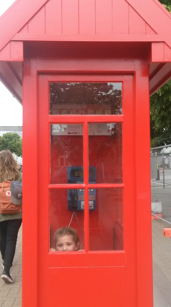 The Buskers were performing in the city center, where there still exist pay phones, in the old English style.  Naomi didn't recognize it as a phone, as she has only ever seen a flat picture-taking device that fits in a pocket.  Cheese!  Take a photo for posterity!
