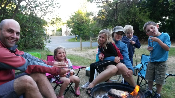Summer means beach weekends and barbecues.  Jeremiah enthusiastically chars meat on our portable grill wherever we go.  In this case we're camping at Gore Bay with our friends Laura, Audrey and Noah.