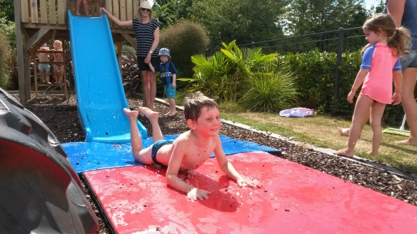 Today playcentre was back on for Naomi but Milo's school hadn't yet started, so big brother came back to playcentre.  A hot day, we made a water slide, fantastic fun for all.