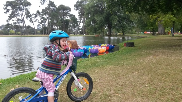 Naomi is lovely.  She really is.  Here she is admiring the floating lanterns as she biked along a lake in Hagley park.